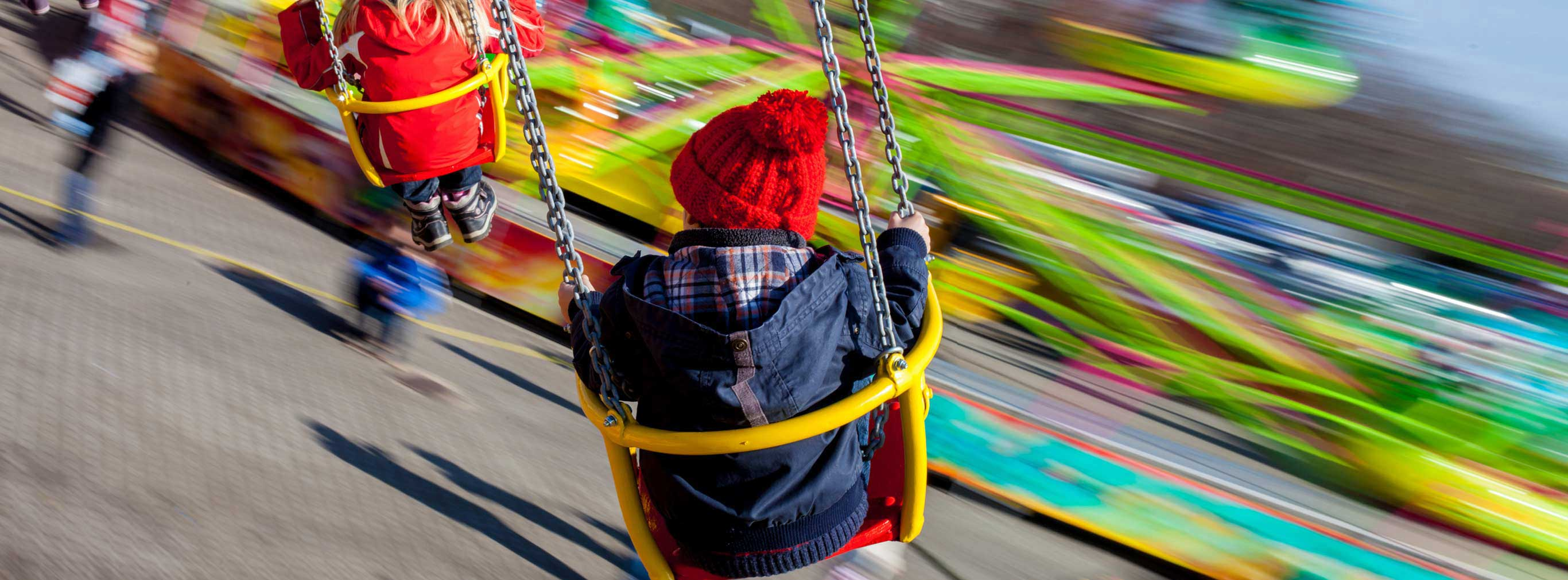 carnival amusements of s a kids having fun on a swing chain carousel ride