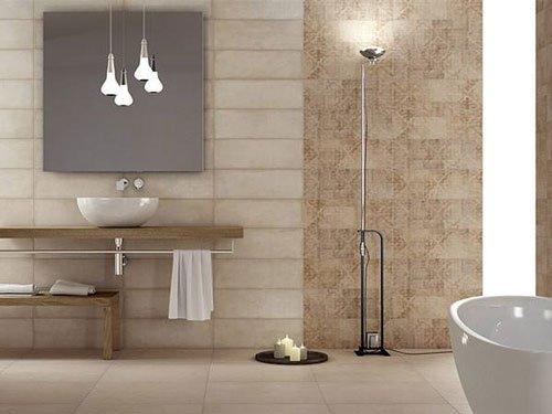 un bagno con un lavandino ovale e delle lampadine a sospensione