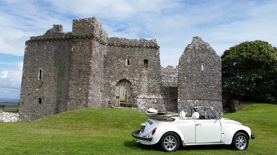 white car amidst the landscape
