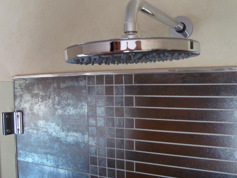 Rivestimento doccia in mosaico