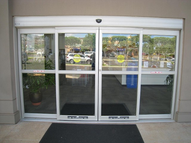 Automatic storefront entrance doors door