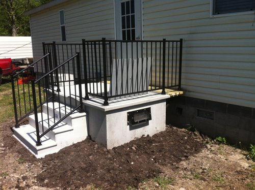 Tornado shelter lowell ar safeporch storm shelters for Porch storm shelter