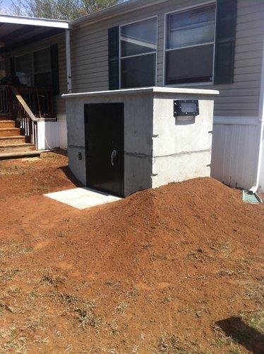 Tornado shelter lowell ar safeporch storm shelters for Porch storm shelter