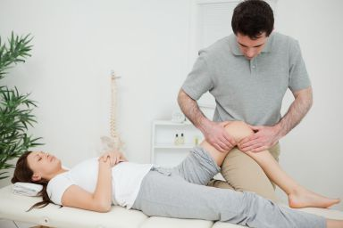 Woman receives chiropractic treatments in a chiropractic center in Lexington, KY