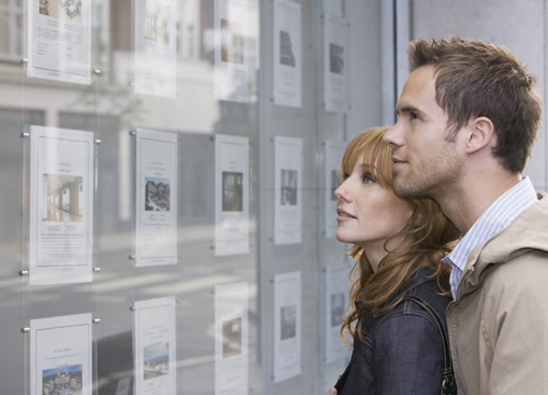 A couple looking at the real estate listings