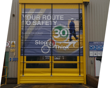 A high speed door with vision panels and printed design
