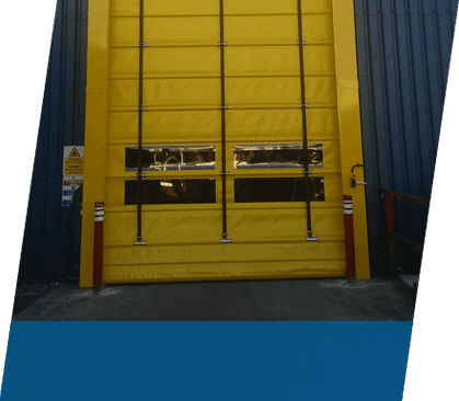 A yellow high speed door with vision panels
