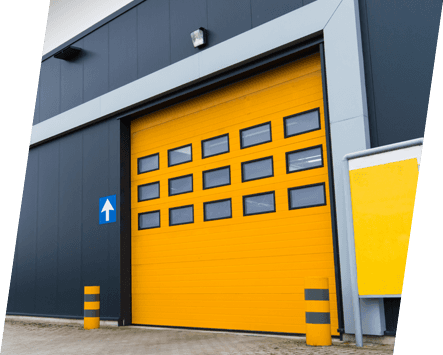 A yellow sectional overhead door with vision units