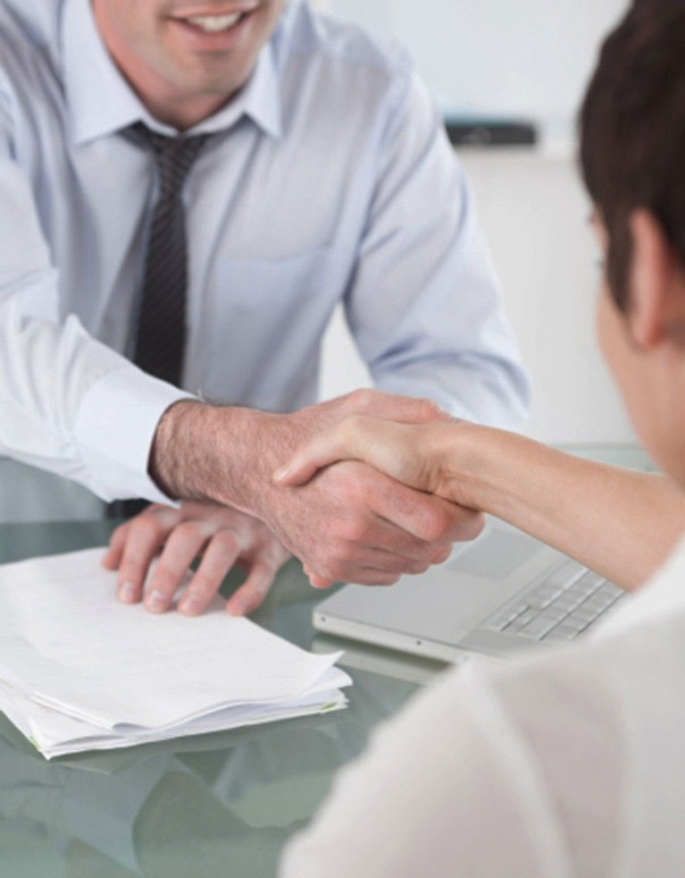 legal entitlements attorney shakes hand with client