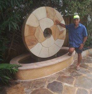 michael livisianos stonemason michael standing near his stone work