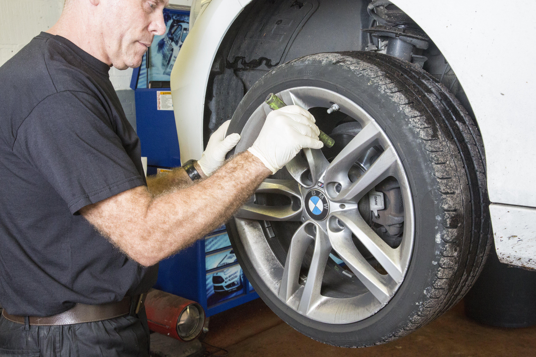 Mechanic inspecting brakes