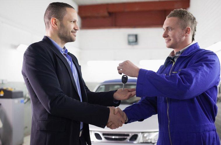 Mechanic handing over keys