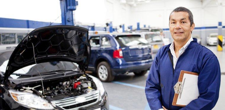 Mechanic holding inspection clipboard