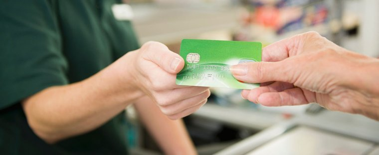 Purchasing fuel using a debit card
