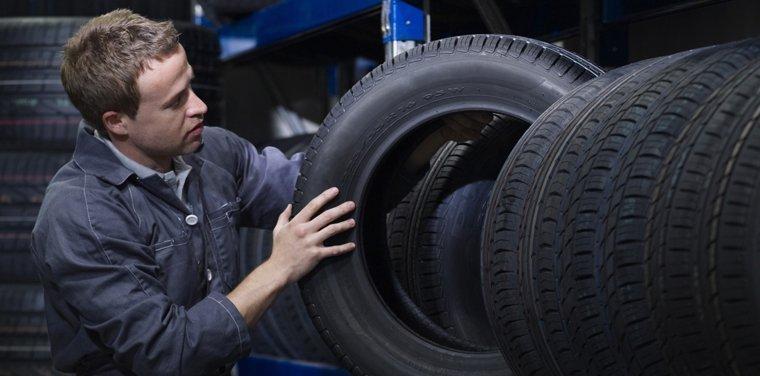 Mechanic selecting new tyre