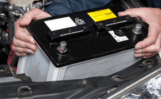 car battery being installed