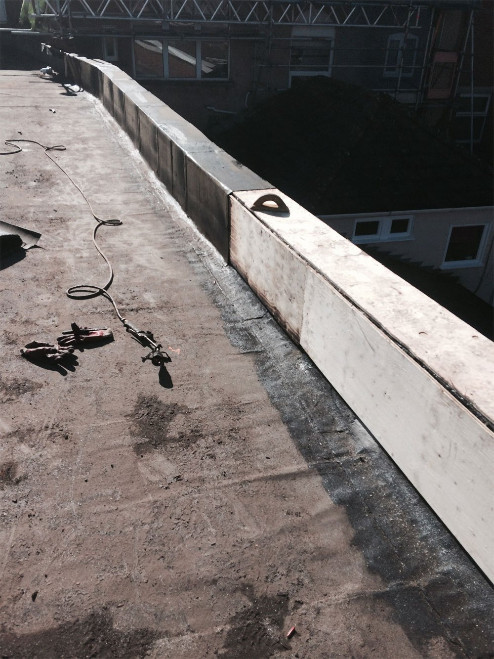 The early stages of a flat roofing project