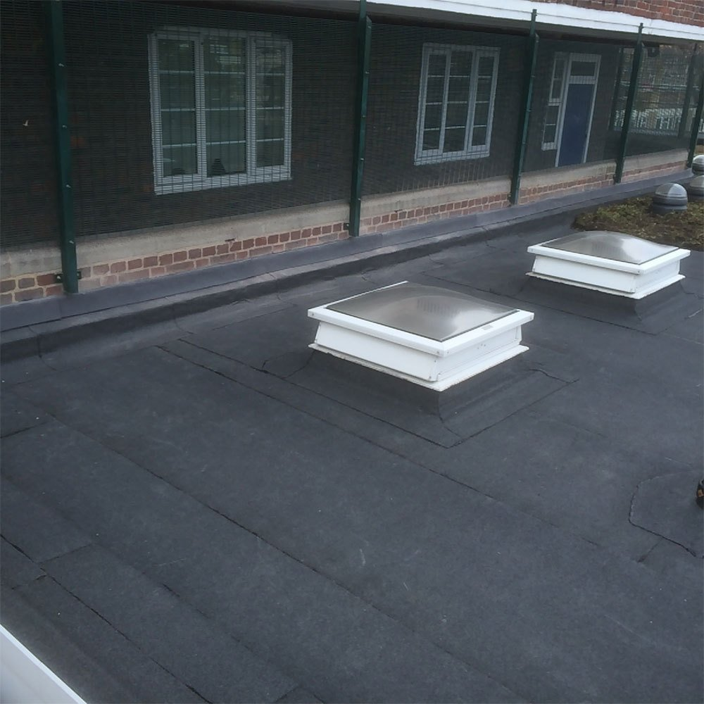 A fully completed flat roofing project