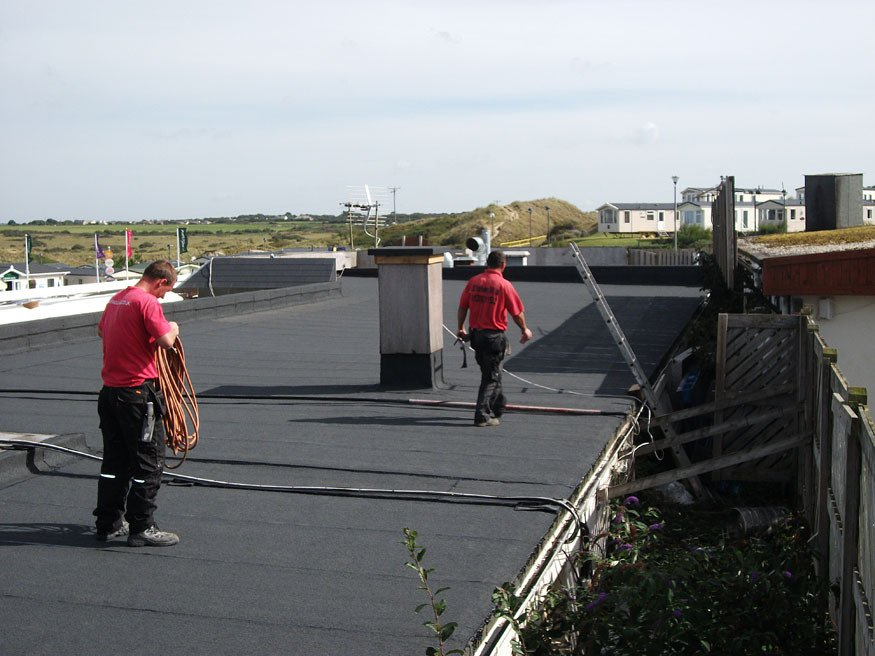 Two of our team members on a Felt Roof