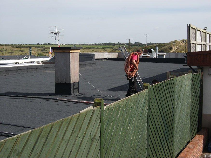 A team member up on a Felt Roof