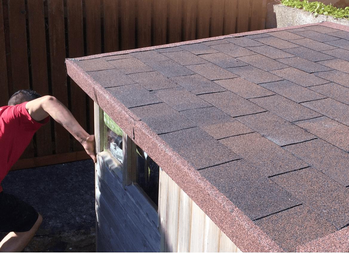 A felt roofing installation in progress