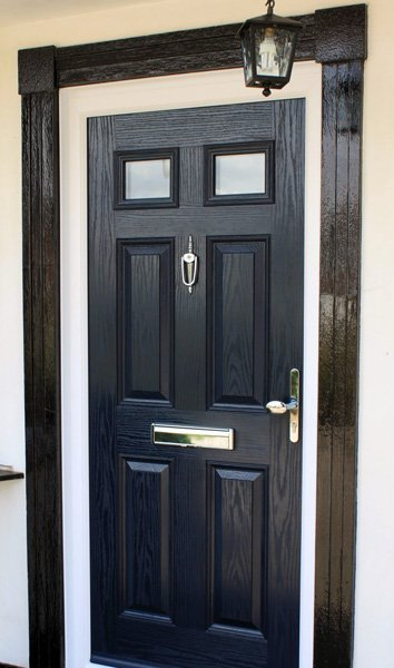 Blue composite door with white frame