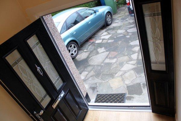 Double composite doors open on to driveway