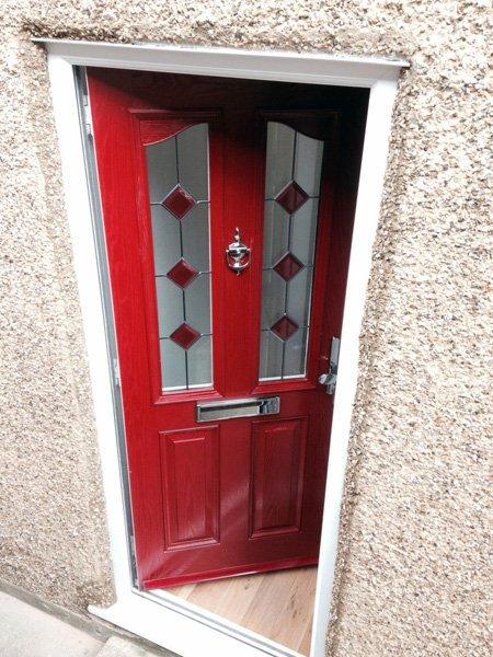 Red composite door ajar