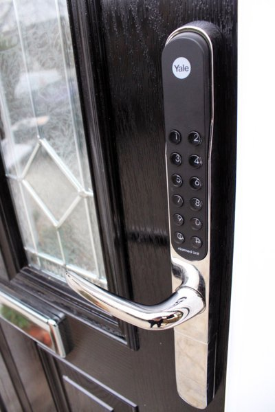 Close-up of the keypad on the handle of a black composite door