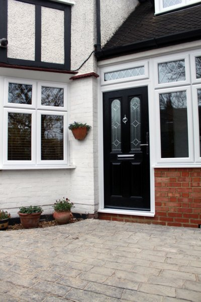 Driveway leading up to a black composite door