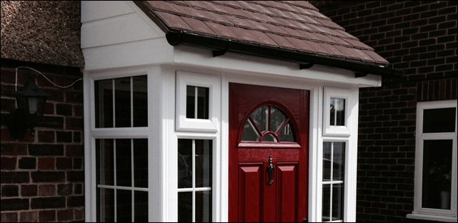 White PVC porch with burgandy door