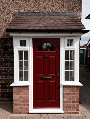 Front view of white PVC porch with burgandy door