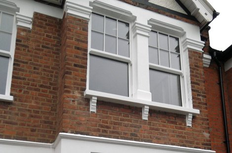 Second storey of a Victorian style house with sash windows.