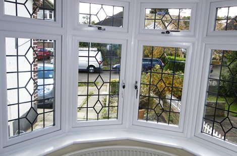 Bay windows from the inside, with a diamond lattice pattern on the glass.