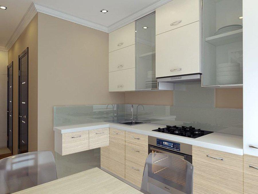cucina con mobilio in legno chiaro e vetro