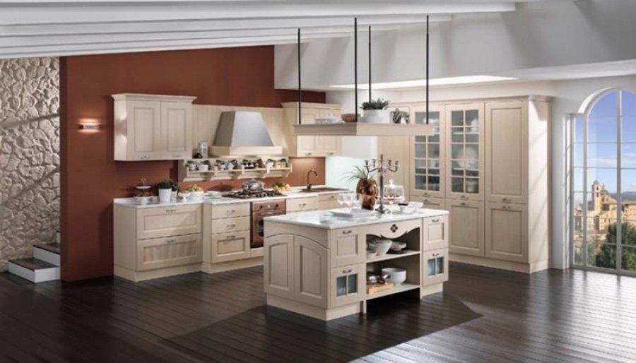 cucina con mobilio bianco e pavimento scuro