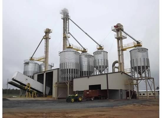 View of a grain bin construction unit with hydraulic dumper in Cairo, GA