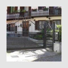 Portone scorrevole,portina centinati e recinzione
