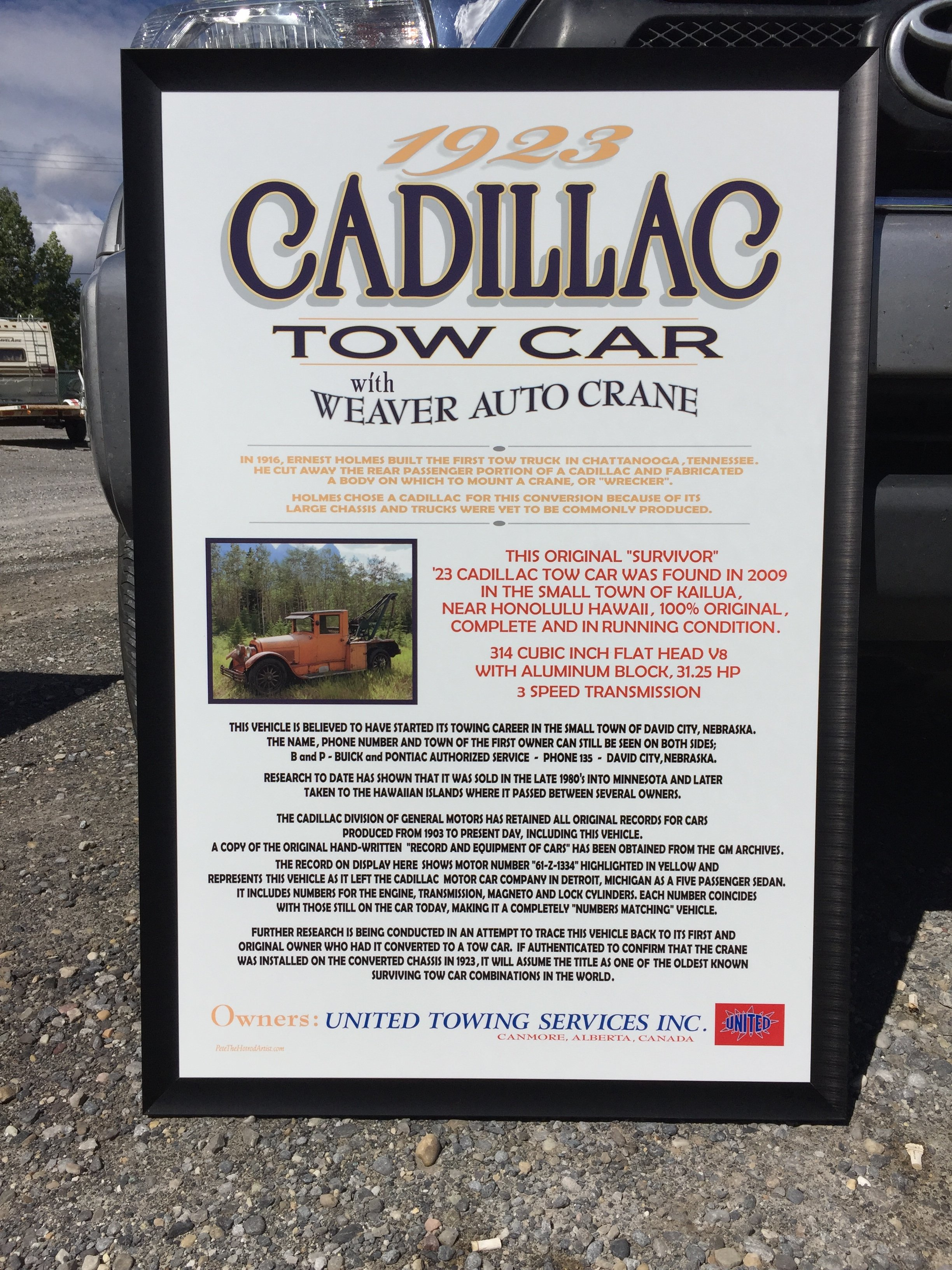 cadillac 1923 tow car sign