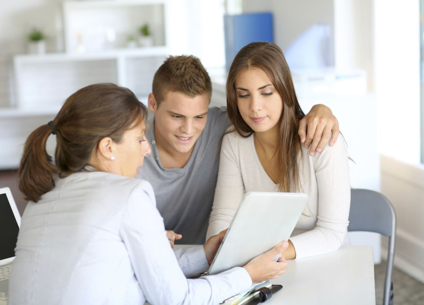 Young couple receives financial advice about home insurance in Wasilla, AK