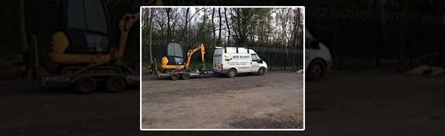 One of our vans in front of a digger