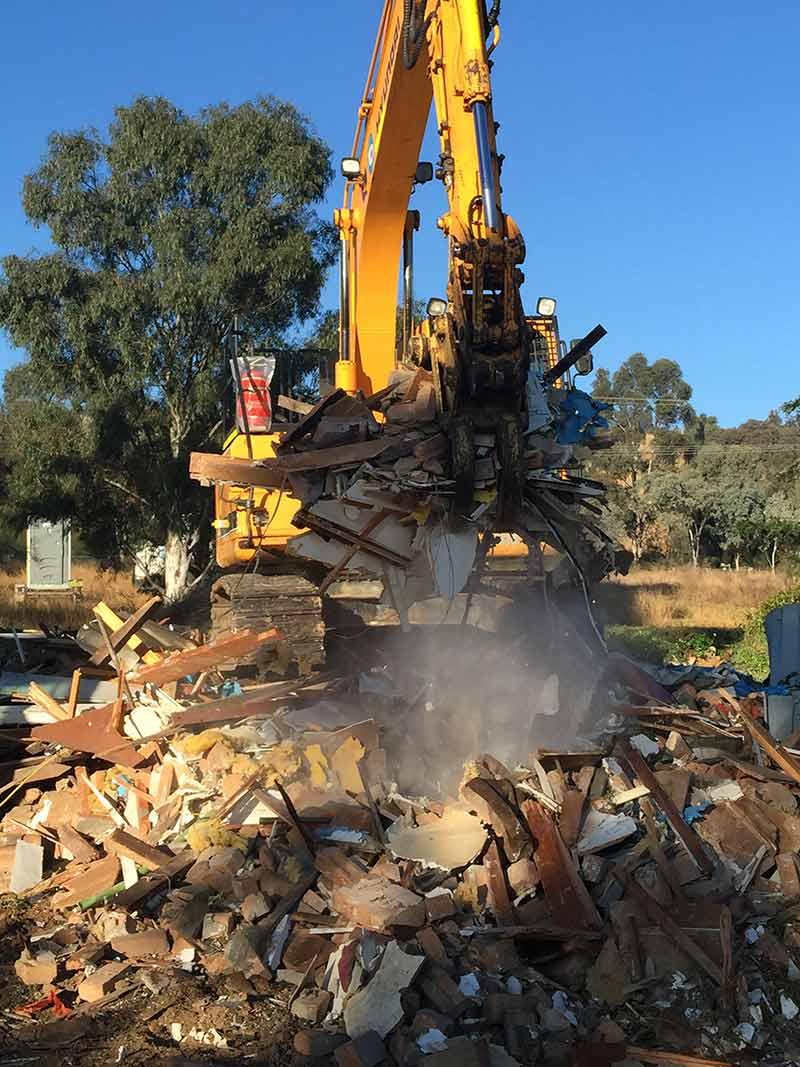 excavator moving rubble