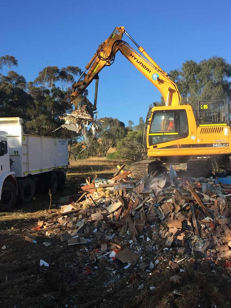 dumping rubble in truck