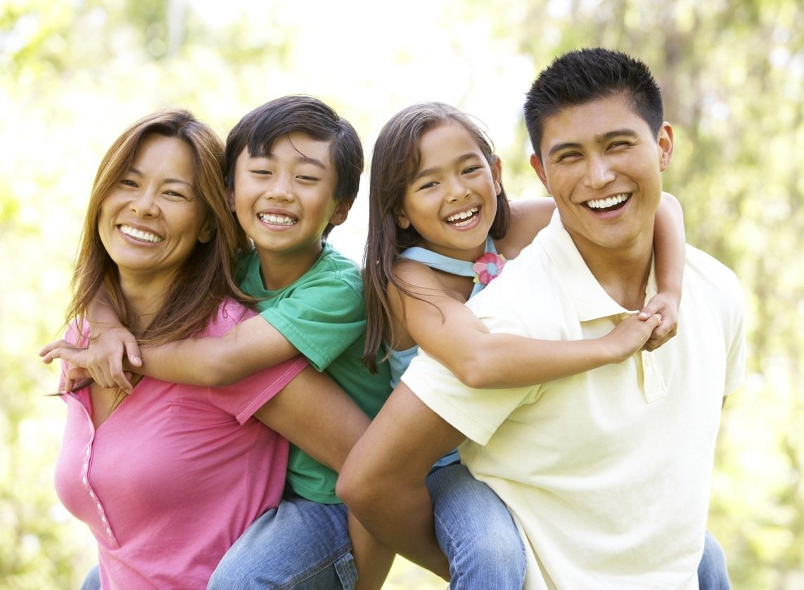 Family with healthy teeth in Pearl City