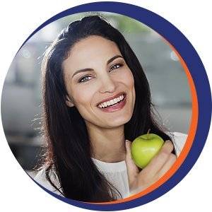 woman smiling with her apple