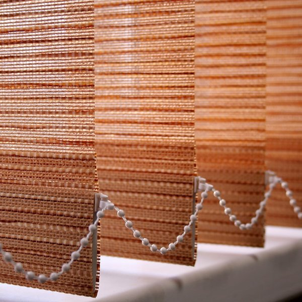 close up of vertical blinds with beading attached