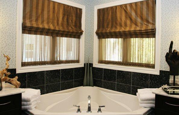 roman blinds over 2 windows in a bathroom