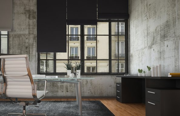 black out blinds over windows in an office space