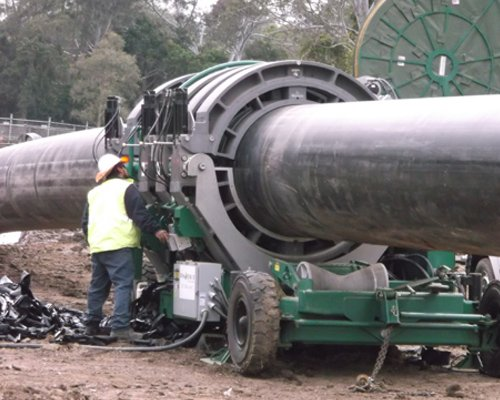 Big pipe being repaired by team of experts