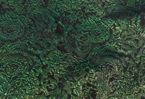 tessuto verde e nero con stampe floreali